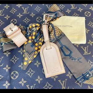 Louis Vuitton large leather tag and handle holder